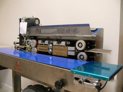 Apolo S1000 horizontal band sealer w/air suction +coder